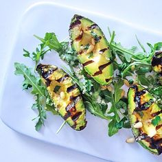 The weather might not yell summer but this chargrilled avocado with pine nut dressing does. Eaten with soft - ish boiled eggs and rye toast.  forgot how good this was. The recipe is on my site  #tessward #thenakeddiet #recipe #brunch by tessward