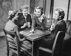 """Four ladies playing Bridge in yesteryear. Today's bridge players don't """"dress"""" up."""