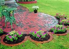tons of landscaping ideas  I have a circular patio but I have a black thumb... I would have to hilight my solar lighted resin stuff, not real flowers or shrubs...But I love the baby circles around the main patio.
