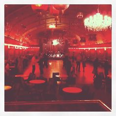 Rivoli Ballroom, Brockley - the only intact 1950's ballroom remaining in London. It's not Chicago, but it's got the air and feeling that I wanted our time travelling jazz club to have - a bit smoky, red velvet, warm red glow. (Cora Clarke for TT Brief)