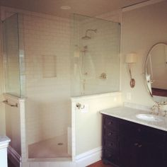 subway tile with small tile on the floor -- love the half walls too