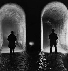 George Konig Two sewer workers examine the Fleet sewer at low water level, London, January 14, 1914.