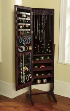 Our Jewelry Armoire is a full-length mirror with a secret—it opens to hold and organize LOTS of jewelry! No more tangled necklaces and chains, no more missing earrings—they all fit. Interior is plush-lined with ring pockets 2 bracelet bars Holders for 28 earrings 29 hooks for hanging longer necklaces and chains 3 shelves with raised fronts add to your organizational possibilities