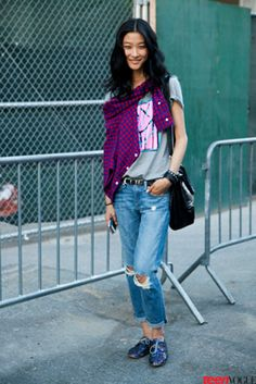 N YFW 13 street style - A model keeps it casual between shows in distressed boyfriend jeans and sweet sparkly Oxfords.