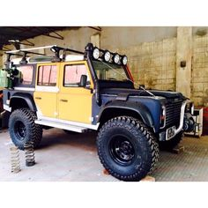 """Insane looking Land Rover Defender 110LWB in Camel Rally Colours with British military standard issue Wolf rims and 40"""" tyres."""