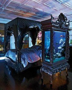 fish tank in ornate, vintage cabinet