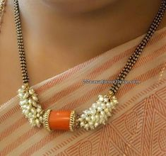 The collection presented here is a mix of coral beads fixed into the black bead set up. Gold Mangalsutra Designs, Gold Earrings Designs, Beaded Jewelry Designs, Jewelry Patterns, Gold Designs, Handmade Jewelry, Fancy Jewellery, Gold Jewellery Design, Bead Jewellery