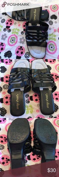 Easy Street Seaside slide sandals NWOT These bright Easy Street Seaside slide sandals are bound to become your shore thing warm-weather favorites! Basic black will go everywhere with everything! NWOT perfect Condition Never worn. Check my closet for other similar items. No trades. easy street Shoes Sandals