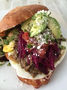 Pork Chili Verde Torta w/ braised cabbage, avocado, fresh cotjia and over hard egg. Genesse Royale Bistro