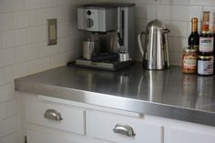 Budget kitchen countertops ideas: sheet metal, tile, wood & clay