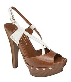 "Jessica Simpson Laisha Slingback Platform Sandals | Dillards.com Description: We love the subtle Western vibe of the Laisha sandal from Jessica Simpson. The crisscrossing leather straps sit atop a wooden platform and heel that is adorned with gold metal studs for a touch of glamour. leather upper synthetic lining synthetic outsole 5.31"" heel $49.99"