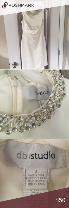 Davis Bridal Cap Sleeve Dress David's Bridal Cap Sleeve Dress with Crystal and Pearl stones neckline! Is beautiful and in excellent condition. Worn only to my wedding rehearsal. I also have shoes that match with it perfectly for sale. db studios Dresses Wedding
