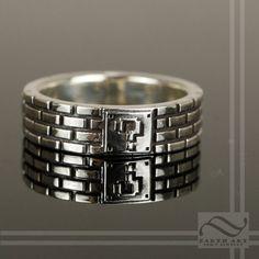 Jess' ring http://www.etsy.com/listing/151831791/super-mario-bros-brick-ring