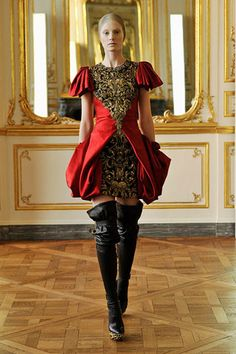 Alexander McQueen's Fall 2010 look is of Baroque influence.  Baroque period was characterized by raised waistlines and tigther clothing with intricate embellishments. The red and black color creates a dramatic visual flow, along with the long black boots. 4/5/15.