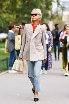 - Ahh, the power of red. The universally flattering shade pops against a faint plaid and distressed jeans.