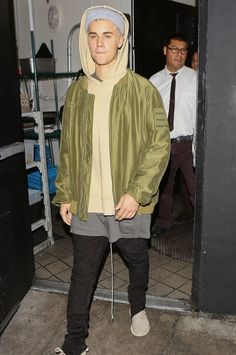 Justin Bieber wearing  Undercover Blouson Undercover Homme, Supreme Loose Gauge Beanie, Adidas Yeezy Boost 350 , Fear of God The Everyday Hoodie
