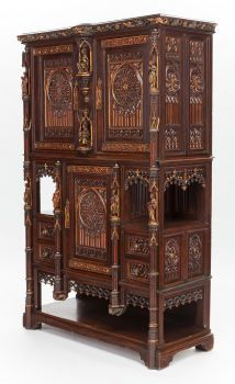 Furniture : Continental, A GOTHIC REVIVAL CARVED WOOD AND PARCEL-GILT CUPBOARD. 19thcentury.