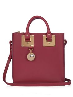 Sophie Hulme's Albion bag comes in a rich plum-burgundy shade that's perfectly complemented by the signature gold-plated brass hardware. As practical as it is playful, it comes with a googly-eyes charm, internal zipped compartment, and optional shoulder strap. Wear it against classic camel, navy, and grey tones.