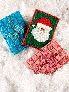 Mini Gift Holders Plastic Canvas Pattern Downloads from e-PatternsCentral.com -- This set of 3 handy plastic canvas holders fit gift cards for an extra-special surprise.