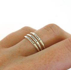 These dainty stacking rings are perfect for personalizing with your childrens names, dates, or a meaning word of your choice. The rings are sold individually. The price is for ONE ring (please adjust the quantity in your shopping cart to order more than one.) ************************************************************ The rings are created from solid sterling silver or solid 14k yellow gold. I use round wire to create the band, but forge a small section at the top flat. It is on this…