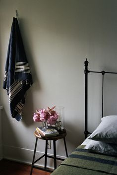 Blankets. Stool as bedside table.