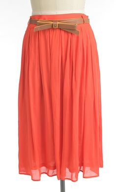 Modest knee length a-line skirt with vintage pleated look and added belt available in coral S-L.