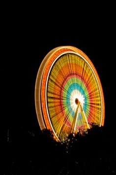 Photo - Ferris wheel at night -Slow shutter speed Shutter Speed, Slow Shutter, Color Photography, Exposure Photography, Neon Lighting, Installation Art, Black Backgrounds, Color Splash, Cool Pictures