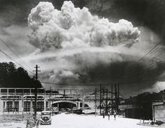 1945-August-09 Nagasaki, Japan. The exact moment of detonation was captured in this remarkable photograph. Notice the 3 people in the foreground, as yet unaware that anything has happened. The destruction of Nagasaki followed that of Hiroshima by 3 days and compelled Japan to surrender, ending World War II.