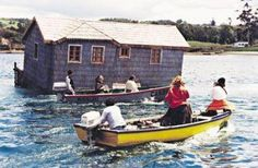 Now this is an interesting tradition from Chile called Minga. Especially the island of Chiloe is famous for involving the whole community to literally move a house. To move a. Patagonia, Andes Mountains, House By The Sea, Pacific Ocean, Geography, Peru, Habitats, Around The Worlds, Photos
