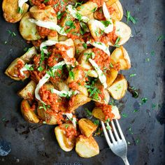 """Patatas Bravas is an addictive Spanish starter, but it's pretty heavy on the calories… You'd never know this recipe was """"lightened up"""" when you try it! I eat and enjoy everything recipe I publish on this blog… but this one is something else. I think it might be how much I've been craving patatas bravas …"""