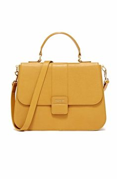 Boxy medium satchel bag with clean, classic lines in a beautiful golden yellow hue with gold hardware. Gold yellow top grain Spanish cowhide and dark blue cotton lining. Snap fastening front flap. Two separated compartments and zipped hidden pocket and square hanging leather pocket with logo. Gold yellow detachable leather strap. All Mahon bags are handcrafted by traditional luxury artisans at their atelier in Spain. The perfect way to add a pop of color to your look - fits all your…