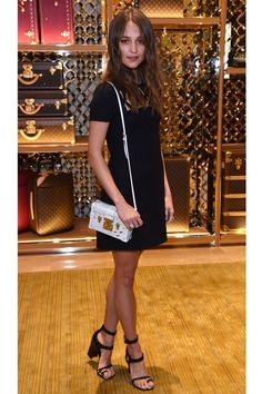 Alicia Vikander in a custom Louis Vuitton LBD, with a LV bag & Louis Vuitton Resort 2015 Double Strap Sandals, at the Louis Vuitton Pre BAFTA dinner hosted by Michael Burke and Alicia, in London on February 13, 2016.  Photo: Getty.
