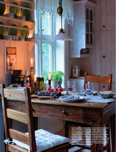 cozy old-fashioned kitchen. plate rack, rustic table and chairs (turned out from the wall, not against the wall)