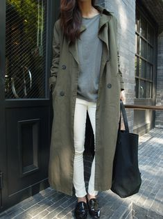 grey sweater, olive jacket, white jeans & black loafers