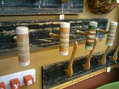 Croquet mallets or coat hangers made into wall racks!