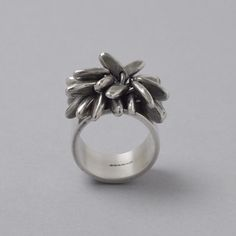 Wide 10mm silver band with a 20 pompom decoration.