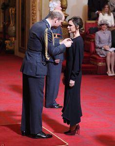 David and Victoria have both been awarded an OBE for services to football and fashion (pic...
