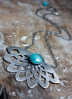 simple, clean, strong, beautiful hand-cut dahlia, reminds me of lily reflection in pond... (etsy camlodesigns)