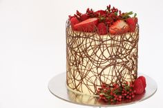 In this video tutorial I demonstrate how to create a delicate and elegant chocolate boarder around a cake decorated with fresh berries and flowers. For more ...