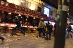 People run after hearing what is believed to be explosions or gun shots near Place de la Republique square in Paris