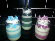 Three top quality soy wax candles scented in Christmas spice. They are whipped and dreamy, the blue and lilac candles are £18.00 each and the  large black and white one is £24 extra .00.