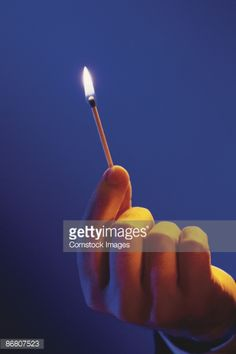 Man Holding Lit Match Stock Photo | Getty Images