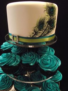 Hand Painted Peacock Feather Wedding Cake with Teal Buttercream Cupcakes. Maybe with purple frosting instead of teal Peacock Cake, Peacock Wedding Cake, Wedding Cakes, Peacock Theme, Feather Cake, Peacock Cupcakes, Teal Cupcakes, Peacock Colors, Cupcake Wedding