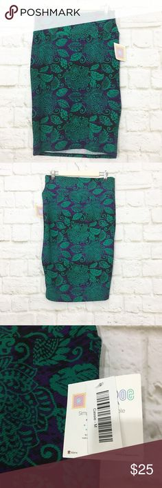 NWT Lularoe Cassie floral stretch pencil skirt Black purple and green pattern, size Medium, brand new with tags. Very comfortable and versatile skirt. LuLaRoe Skirts Pencil