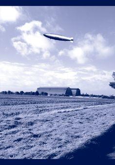 R101 airship art, over the sheds at Cardington