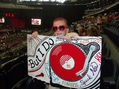 Avery with his poster inside Dallas Cowboy Stadium for Taylor Swift :)