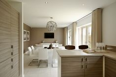 The #kitchen, dining and family area at the back of the home has French doors opening onto the garden.  #Strata