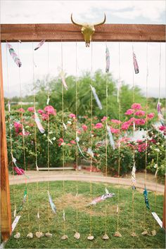 Southwestern inspired wedding decor with feather hangings. #weddingceremony #decorideas #weddingchicks Captured By: Vis Photography ---> http://www.weddingchicks.com/2014/05/05/southwestern-inspired-wedding/