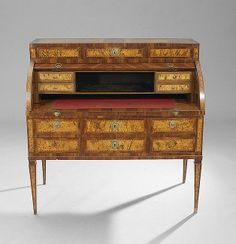 """Italian Walnut and Burl Walnut Cylinder Desk, early 19th century, the banded top above a single long drawer, faced as three, over a cylinder opening to a pull-out writing surface and a variety of drawers and a central cubbyhole, above three small banded drawers and a single like-faced long drawer, raised on tapering square legs, h. 44-1/2"""", w. 45-1/2"""", d. 22-1/4""""."""