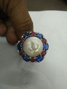 Pearl,ruby and bluesafaire ring